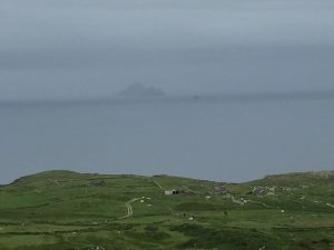 Skellig Michael just visible through the sea mist