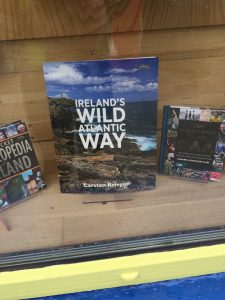 Must go there sometime. Book in shop window in Moville